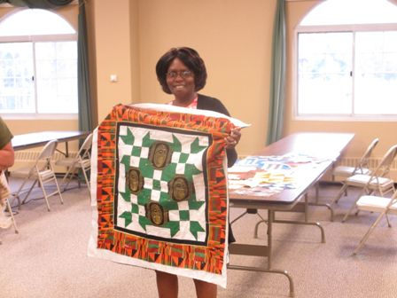 Nellie-new-member-with-her-beginners-class-quilt