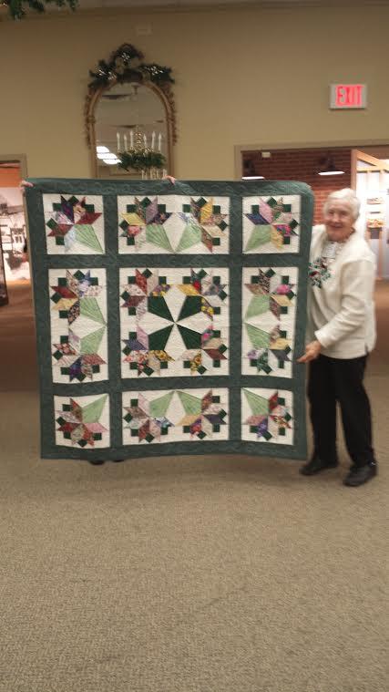 teresa winner of raflle quilt to benefit community service
